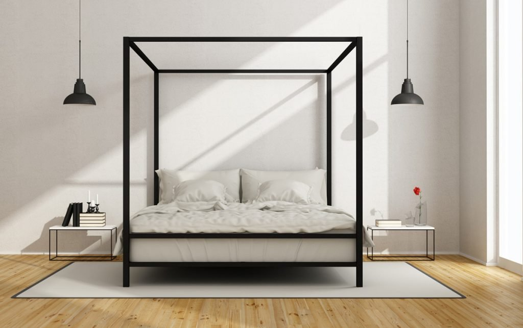 White bedroom with canopy bed