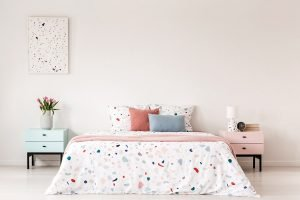 colorful comforter with bed