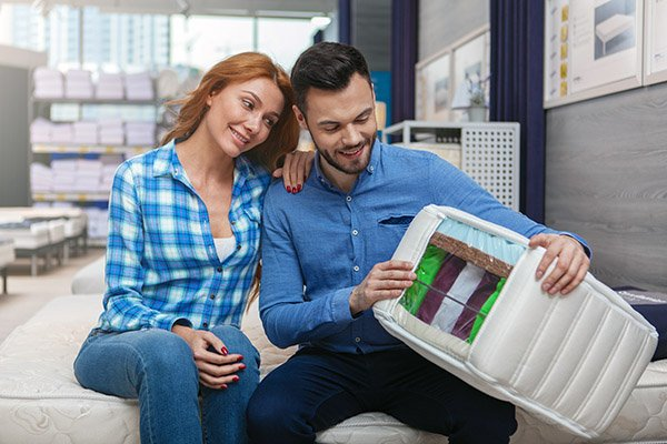 couple happy with a mattress